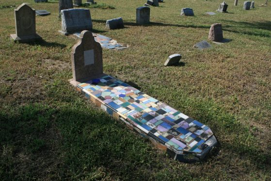 Tombstone decoratively covered in ceramic tiles